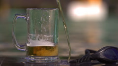 Beer pouring to the glass, steadycam shot, slow motion shot Stock Footage