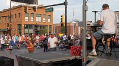 Dancing to the music at a street fair - stock footage