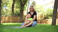 mother and son having fun in the park 2 HD Footage