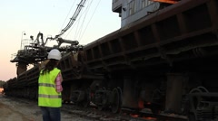 Manager controls loading cargo train Stock Footage