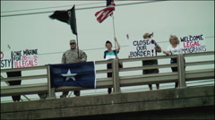 Anti-illegal immigration protesters overpass Stock Footage