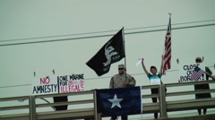 Anti-amnesty protesters overpass flags tea party Stock Footage