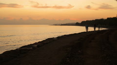 People jogging on the beach, exotic place, morning Stock Footage
