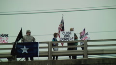 Protesters anti-amnesty overpass Stock Footage