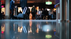 People walking and waiting for airplanes at the airport Stock Footage