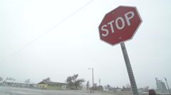 Stop sign shakes as windstorm sweeps through Indian Reservation Stock Footage