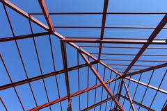residential construction home, steel beams with blue sky at construction site - stock photo