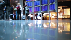 People walking on the airport next to duty-free zone Stock Footage