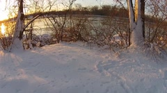 Sunrise along snowy river. Stock Footage