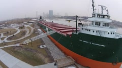 Ship docked in Icy river and snow, camera pans around front Stock Footage