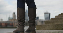 Back of woman standing, zoom into London skyline 4K Stock Footage