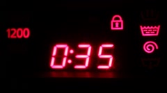 Flashing electronic display the number on the washing machine Stock Footage