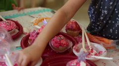 Kids decorating cup cakes Stock Footage