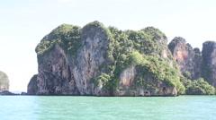 island rocks floats in azure sea - stock footage
