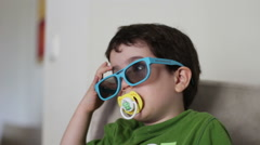 Kid with 3D glasses watch 3D content Stock Footage