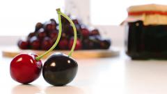 Fresh cherry and cherry jam jar in the background Stock Footage