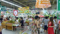 people pick and buy fruits in the supermarket in Chengdu, Sichuan, China - stock footage
