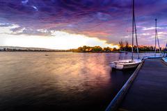 Sailing boat at sunset Stock Photos