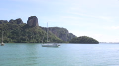 Sailboat anchored in ropical island Stock Footage