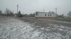 Rez trailer during ground blizzard Stock Footage