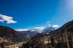 alp peak in a sunny spring day - stock photo