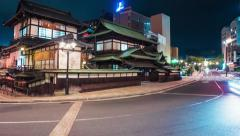Time lapse of traffic surrounding the ancient Japanese bathhouse Dogo Onsen - stock footage
