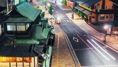 Time lapse of traffic surrounding the ancient Japanese bathhouse Dogo Onsen Stock Footage
