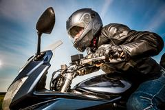 biker racing on the road - stock photo