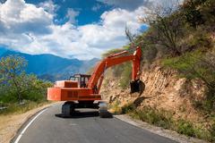 Excavator repair the road. Stock Photos