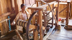Inle lake, myanmar - circa jan 2014: woman working with the old mechanism for Stock Footage
