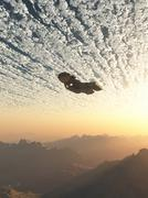 Spaceship under the Clouds - stock illustration