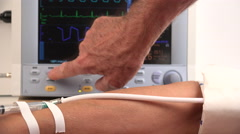 4K Male physician Assistant Checks Female Patient Vital Signs - stock footage