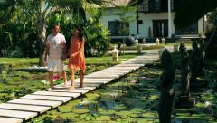 Couple walking and talking on footbridge in beautiful oriental place Stock Footage