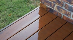 4k Rain Falling on Wooden Deck Stock Footage