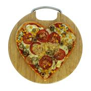 Valentine vegetarian pizza - pizza in the shape of heart Stock Photos