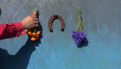 hanging rusty horseshoe and medical herb bunch on wooden wall - stock footage