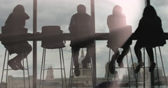 Light rays hit silhouette sitting people 4K Stock Footage