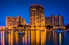 buildings on belle island at night, in miami beach, florida. - stock photo