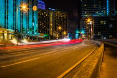 traffic on brickell avenue at night, in downtown miami, florida. - stock photo