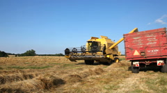 Combine harvester turning in a cloud of dust Stock Footage