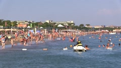 People Crowd on Sunny Summer Resort Hotel Beach Stock Footage