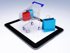 Shopping cart over tablet pc. e-commerce concept. Piirros