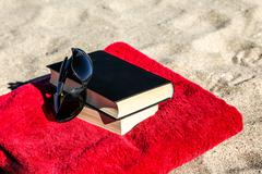 Book on beach Stock Photos
