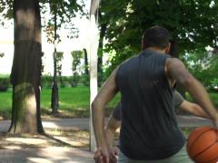 Two men playing basketball on court in park, super slow motion, 240fps NTSC Stock Footage