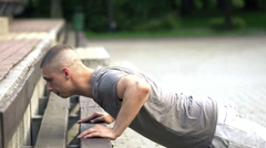 Young man doing push-ups on bench in park, super slow motion, 240fps HD Stock Footage