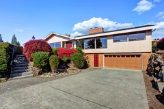 big modern house with curb appeal - stock photo