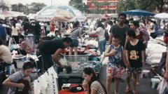 Shoppers Browsing at a Bangkok Night Market Stock Footage