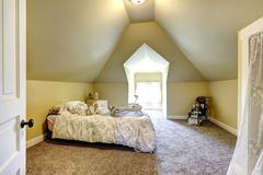 Soft ivory bedroom with vaulted ceiling Stock Photos