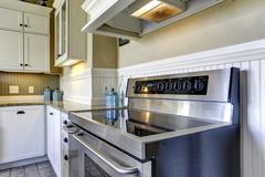 modern kitchen stove with flat top - stock photo