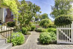green front yard with walkway - stock photo